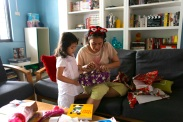 opening_christmas_present_with_mama
